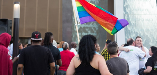 At the Center for Civil and Human Rights, mourners greet and hold each other before a vigil honoring victims of the Orlando Massacre